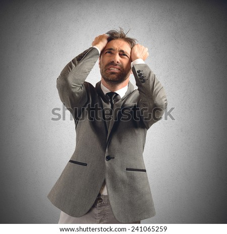 Businessman stressed and desperate for his problems - stock photo
