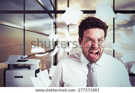Businessman stressed and overworked yelling in office - stock photo