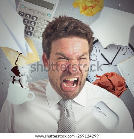 Businessman stressed and pissed from work overload - stock photo