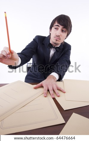 Businessman stressed in his office, many documents on the desk - stock photo