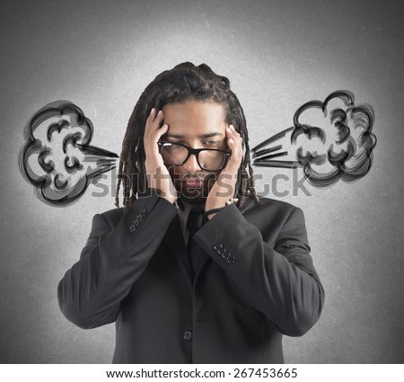 Businessman stressed with the brain in smoke - stock photo