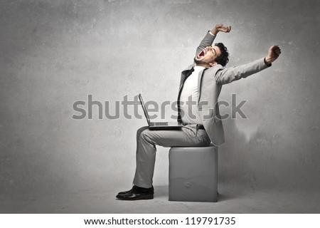 Businessman stretching - stock photo