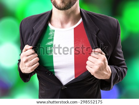 Businessman stretching suit with Italian Flag  - stock photo