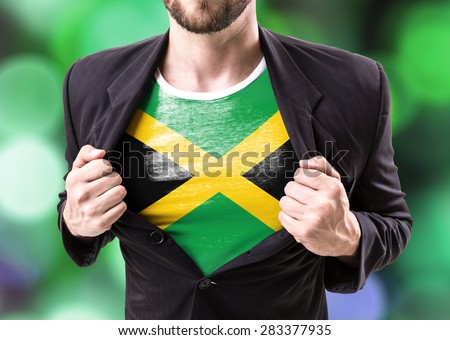 Businessman stretching suit with Jamaica Flag on bokeh background - stock photo