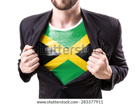 Businessman stretching suit with Jamaica Flag on white background - stock photo