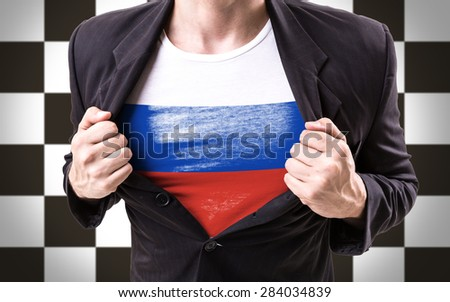 Businessman stretching suit with Russian Flag on checkered background - stock photo