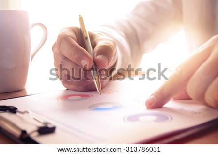 Businessman study financial report. Concept for business, finance, market research, analytics and statistics, marketing. - stock photo