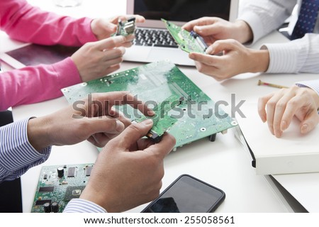 Businessman studying the circuit board - stock photo