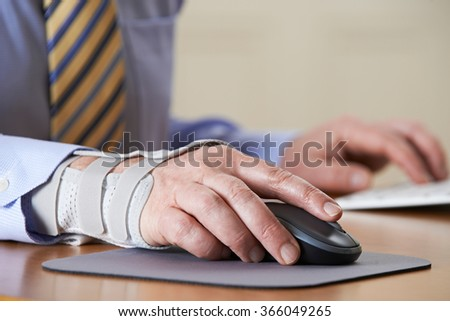 Businessman Suffering From Repetitive Strain Injury (RSI) - stock photo