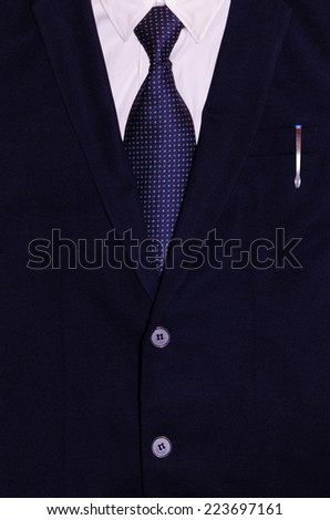 Businessman suit with a pen in the pocket - stock photo