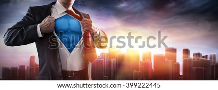 Businessman Superhero With Sunset In City