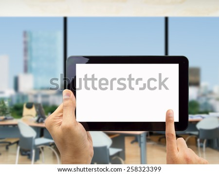 Businessman surfing of a digital tablet at the office - stock photo
