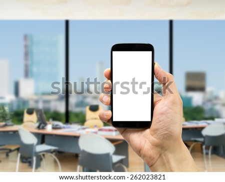 Businessman surfing with one smartphone at the office - stock photo