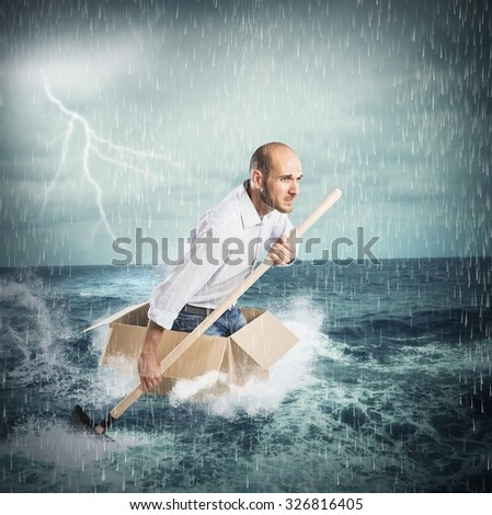 Businessman surfs on a cardboard during storm - stock photo