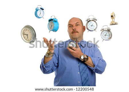 Businessman surrounded by clocks juggling time - stock photo