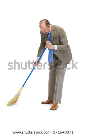 Businessman sweeps a floor on a white background - stock photo