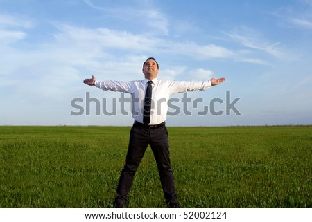 businessman take energy from nature - stock photo