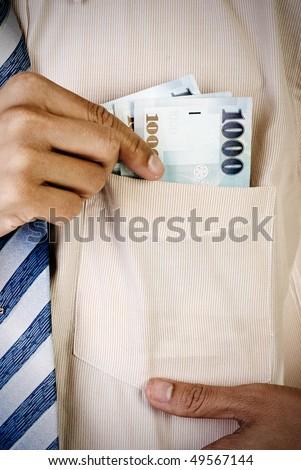 Businessman take money of Taiwan bill form pocket. - stock photo