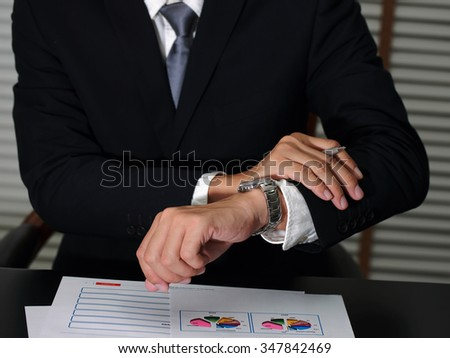 Businessman take time in appointments on time of work as business concept.
