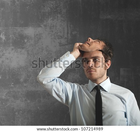 Businessman takes off the mask which hides the face - stock photo