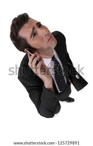 Businessman taking a bad phone call - stock photo