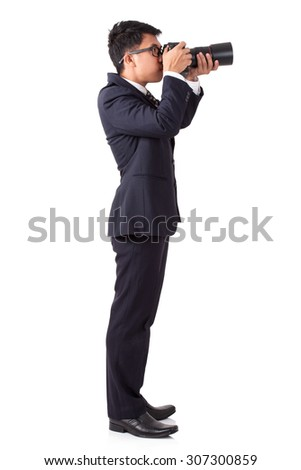 Businessman taking a photo on white background