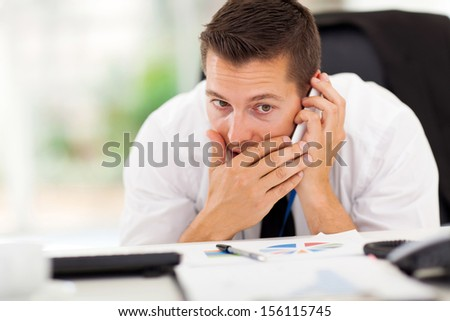 businessman taking a private call during working hour - stock photo
