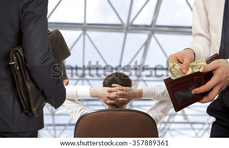 Businessman taking bribe.  Business concept - stock photo