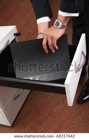 Businessman Taking Documents - stock photo