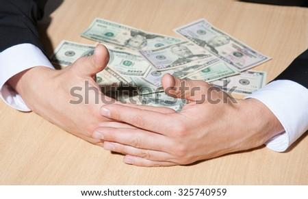 Businessman taking dollars, closeup shot - stock photo