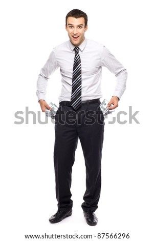 Businessman taking money from his pockets - stock photo