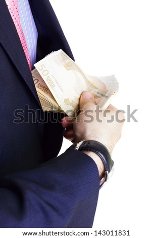 Businessman taking money of his pocket, isolated on white. - stock photo