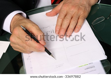 Businessman taking notes - stock photo