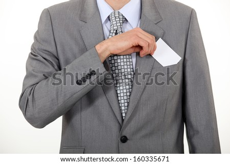 Businessman taking out business card - stock photo