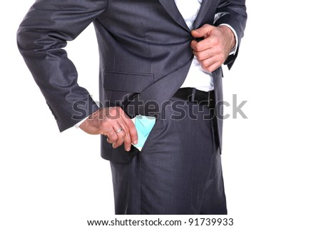 Businessman taking out credit card and some documents out in his pocket, close up - stock photo