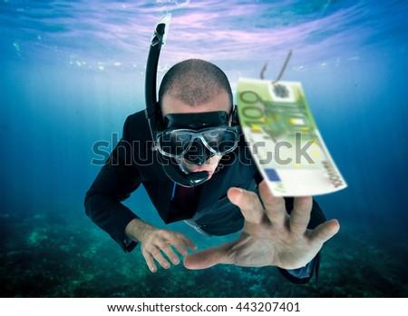 Businessman taking the bait - stock photo