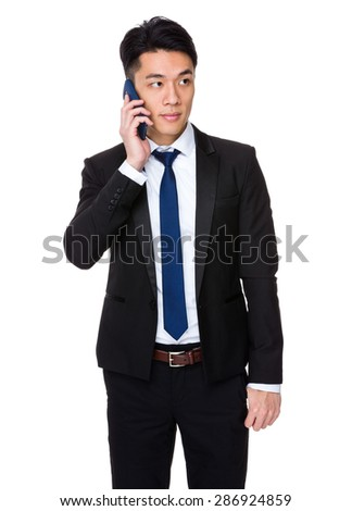 Businessman talk to cellphone - stock photo