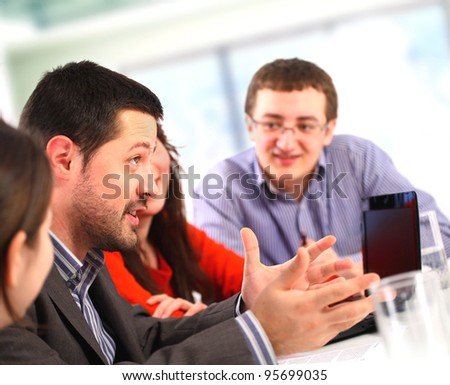 Businessman talking at a meeting - stock photo