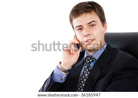 Businessman talking by cellphone against a white background - stock photo