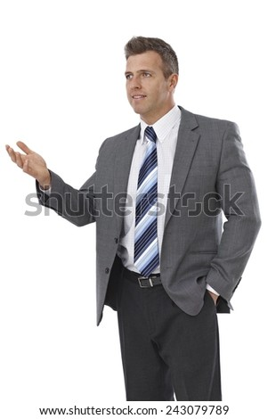 Businessman talking, gesturing with right arm over white background.