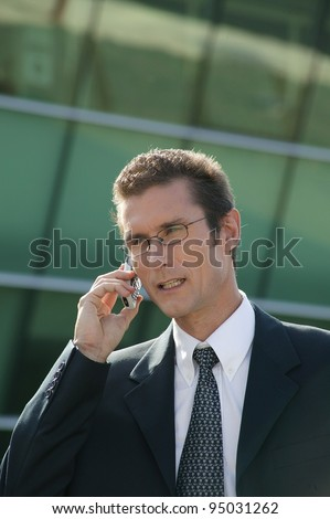 Businessman talking on a cellphone - stock photo