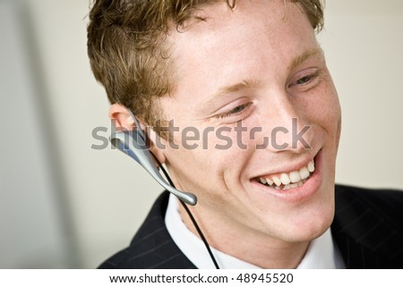 Businessman talking on headset - stock photo