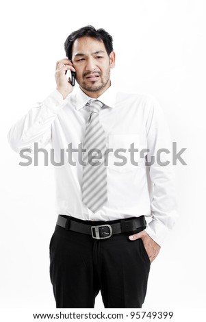 Businessman talking on his cellphone - stock photo