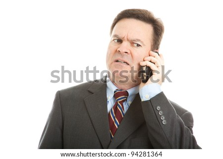 Businessman talking on his cellphone.  Very expressive worried face.  Isolated on white. - stock photo