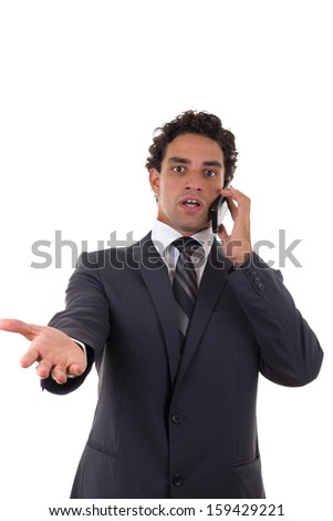 businessman talking on mobile and he is surprised by the response - stock photo
