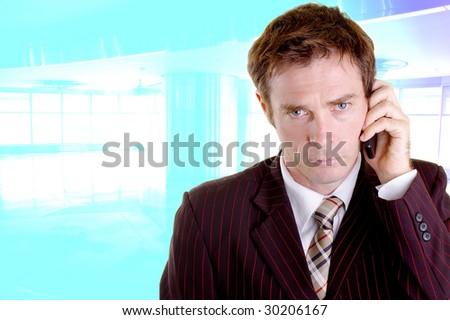 Businessman talking on mobile in inner city office - stock photo