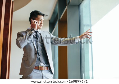 businessman talking on phone - stock photo