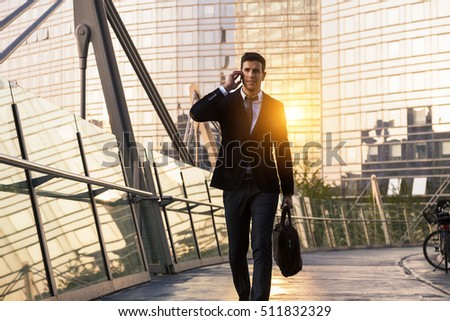 Businessman talking on phone in financial district