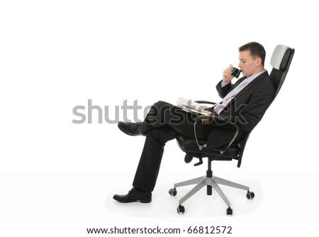 Businessman talking on the phone sitting in a chair in a bright office. Isolated on white background - stock photo