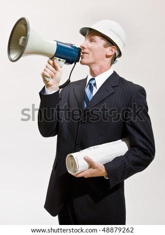 Businessman talking through megaphone - stock photo